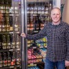 Governor signs bill to gradually allow full-strength beer, wines sales in grocery stores